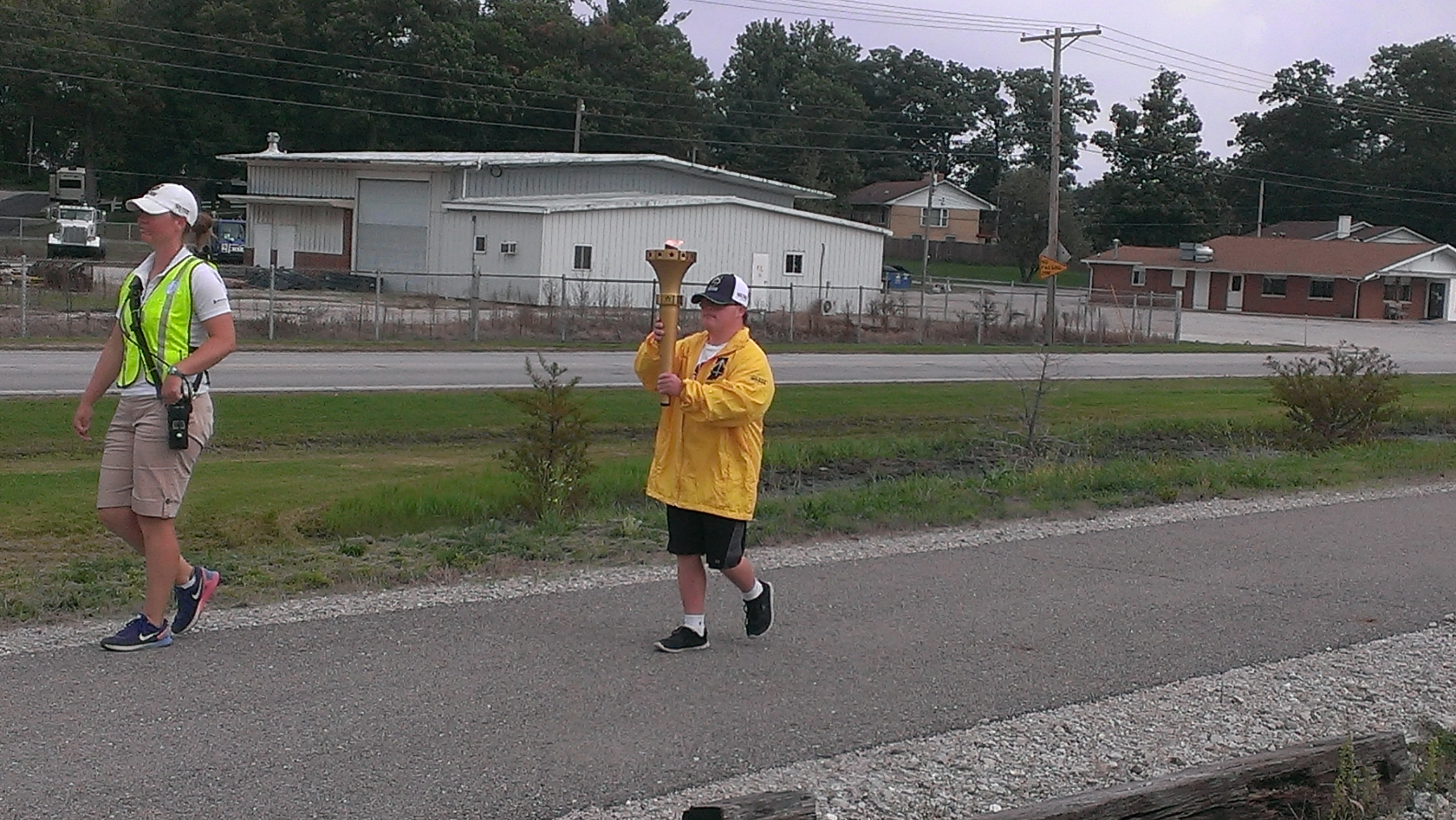 Making his way through Winamac with the torch.